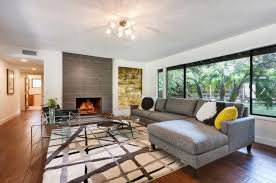 living room mid century modern with fireplace sloped ceiling