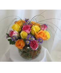 houston flower delivery bright colored dozen roses in glass bowl for a flower delivery in