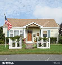 Small Flag Pole House With White Picket Fence Stock Photos Images Pictures