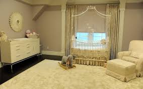 baby room with neutral walls and metal canopy crib beautiful
