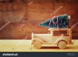 pink glitter car wooden car carrying christmas tree stock photo 507663214