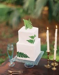 wedding cakes decorated with fresh ferns brides