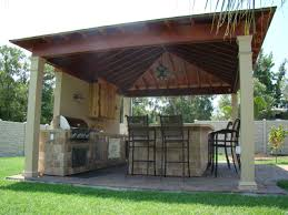 Modern Kitchen Outdoor With Brown Laminated Wooden Canopy And Gray - Stone kitchen table