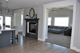 grey hardwood floors and sided fireplace