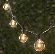 outdoors café style string lights remodelista
