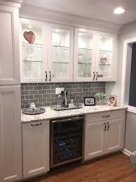 white kitchen cabinets with taupe backsplash white cabinets with taupe glass backsplash and aspen white