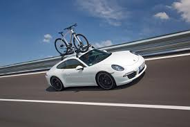 porsche bicycle heading off on holiday in a porsche 911