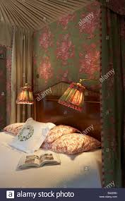Bed Reading Lights Bedrooms Four Poster Detail Lampshades Bed Head Pillows Book Stock