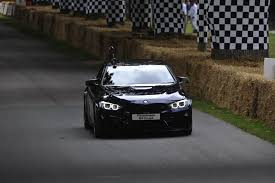 m4 coupe bmw tiff needell drives unique bmw m4 coupe on the goodwood hill climb
