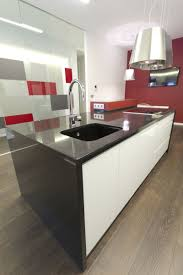apartments black countertops with modern faucet and white kitchen