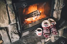 christmas comfortable slippers by the warm cozy fireplace stock