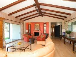 eclectic living room with laminate floors u0026 exposed beam in