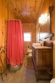 Rustic Bathroom Sconces - bathroom glow sconce bruises over framed vanity mirror in
