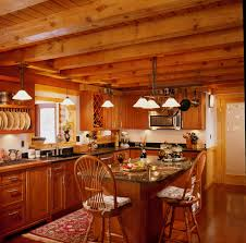 small log home interiors log home kitchen with island and beam ceiling log homes inside