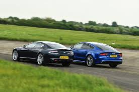 aston martin sedan new audi rs7 performance vs used aston martin rapide luxury