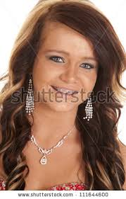 earrings girl girl wearing earrings necklace looking stock photo 111644600