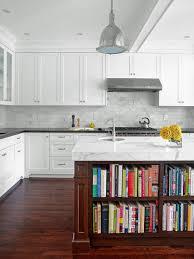 kitchen wide plank floors glazed subway backsplash simple cabinets