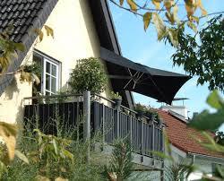 house home designs balcony umbrella by paraflex