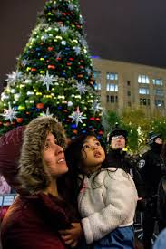 at the downtown seattle tree lighting all eyes are on the sky