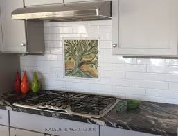porcelain tile kitchen backsplash tree of porcelain tile creates a focal point for a