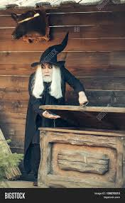 halloween long background old man wizard with long grey hair beard in black costume and hat
