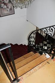 How To Put Rug On Stairs by Remodelaholic Curved Staircase Remodel With New Handrail