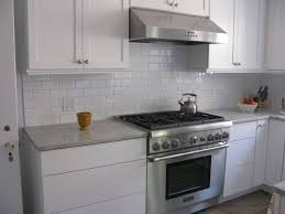 kitchen white glass tile backsplash countertop with dark wood
