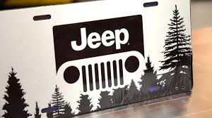 jeep silhouette license plate stainless steel with black jeep grille logo and