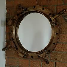 circa 1900 salvaged bronze porthole mirror trend military
