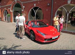 ferrari dealership showroom people admiring a ferrari 458 spider 2012 u002712 u0027 outside meridien