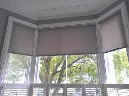 geometric patterned roman blinds in a bay window could work in roller blinds on bay windows google search bay window blindswindow shuttersbow
