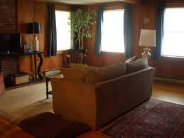 how to decorate wood paneling help with decor for wood paneled living room apartment therapy