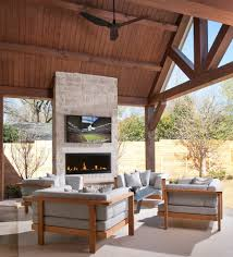 outdoor fireplace and patio midcentury with tile surround
