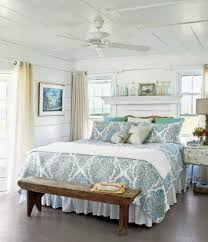 master bedroom cottage style with fand and rustic bench and