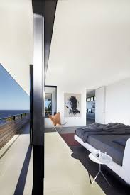 lamble modern beach house with views of the ocean by smart design