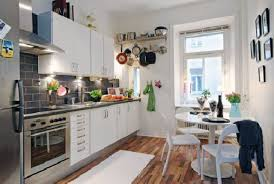decor white kitchen cabinets and dining set with wood floors for