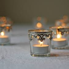 set of two silver and glass tea light holders by the wedding of my