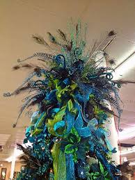 large peacock inspired tree topper with lots of blue and green