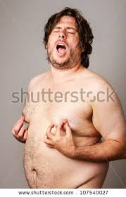 Nude Memes - funny picture overweight man pinching his stock photo 107540027