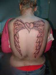 women full back coverup with angel wings and fallen text tattoo