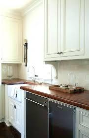 farmhouse sink with backsplash white brick tile backsplash white kitchen with brick butlers pantry