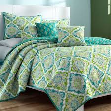 turquoise quilted coverlet zoie turquoise and lime medallion coverlet set by j queen new york