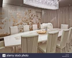 luxury dining room white gold dining room in a luxury apartment in london stock photo