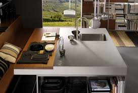 kitchen island with sink and seating concrete tile flooring white