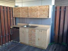 garage cabinets with sliding doors sliding cabinet doors and discreet handles keep the piece looking
