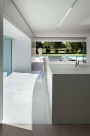 modern gourmet kitchen golf course views and a striking exterior make for a modern marvel