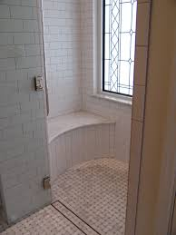 beautiful shower with carerra marble basketweave floor stained