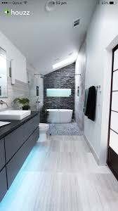long narrow bathroom double shower and vanity glass wall to