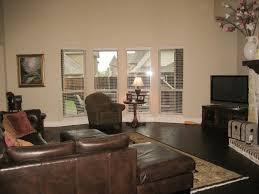 Living Room With Dark Brown Sofa by Living Room Beautiful Line Dark Hardwood Floor With Cream Modern