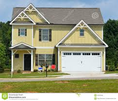 new yellow house and garage royalty free stock photos image